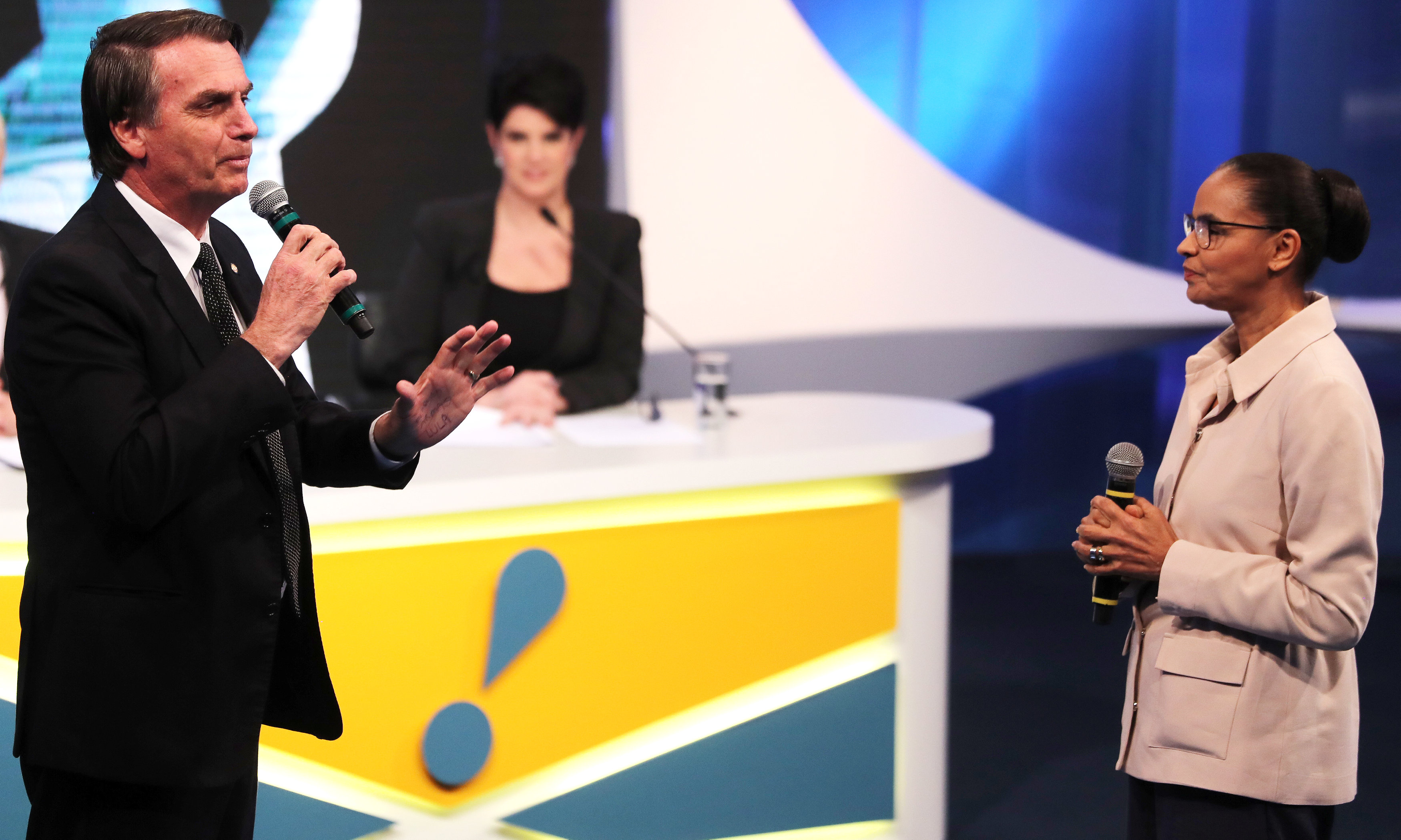 Presidential candidate Jair Bolsonaro of the Party for Socialism and Liberation (PSL) speaks next to candidate Marina Silva of the Brazilian Sustainability Network Party (REDE) during a television debate at the Rede TV studio in Osasco, Brazil August 17, 2018. REUTERS/Paulo Whitaker