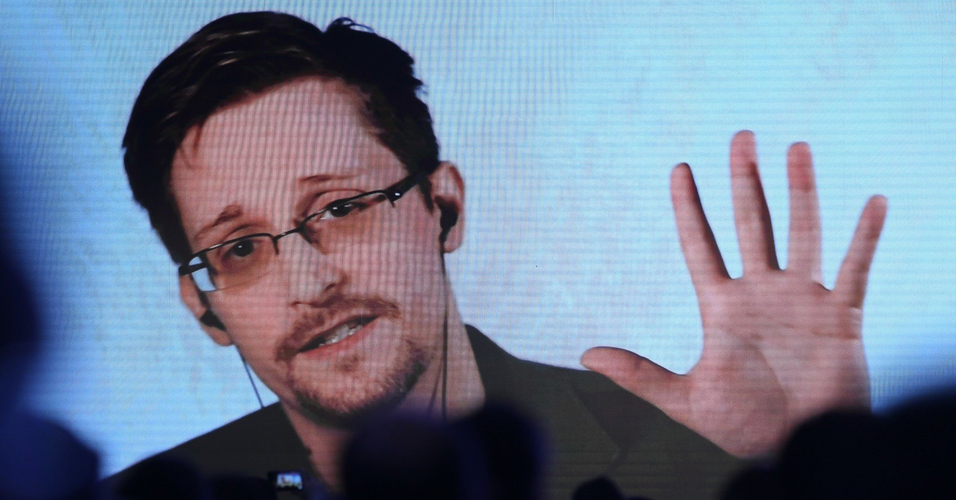 """ISTANBUL, TURKEY - NOVEMBER 21: Former U.S. National Security Agency contractor Edward Snowden delivers a speech by a video conference during a session titled """"How to solve the next generation of Privacy & Security Dillemas"""" within Shield 2017 Cyber Security Conference at Ciragan Palace in Istanbul, Turkey on November 21, 2017. (Photo by Arif Hudaverdi Yaman/Anadolu Agency/Getty Images)"""